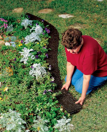 This long-lasting, recycled rubber border keeps grass and weeds from encroaching and lets you mow right along so there's no need to trim.