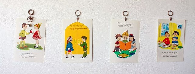 Pages from old children's books as wall art for a kid's room