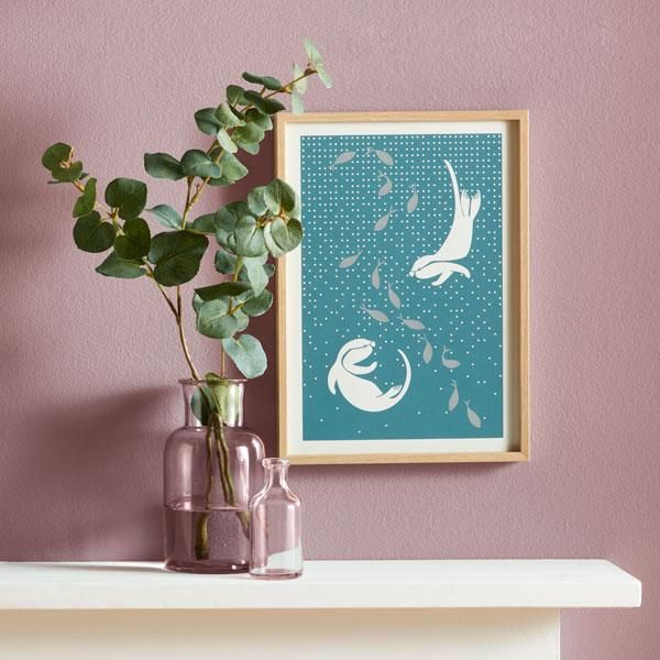 These little otters are swimming playfully with a shimmering, metallic silver shoal of fish. Contemporary in feel, with an almost Scandinavian design aesthetic, each of these art prints has been hand pulled, making each piece unique and individual.