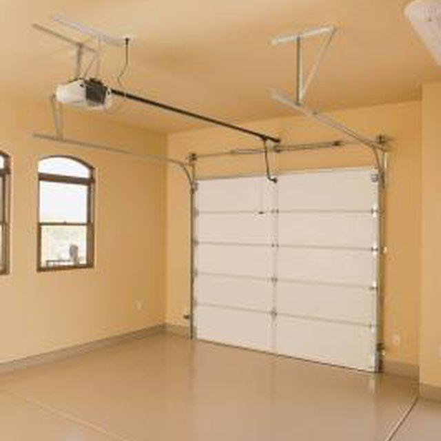 The first step in converting a garage is to remove the door and build a wall.
