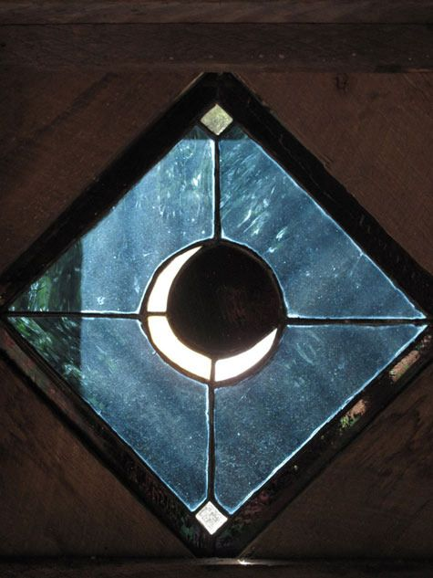 Stained glass window with crescent moon.