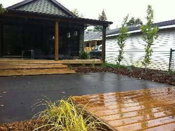 wood deck, meditation pad, stone patio, mulch, grasses. Modern landscape design. Completed by Leaf Garden Design Inc.  | florence Ave
