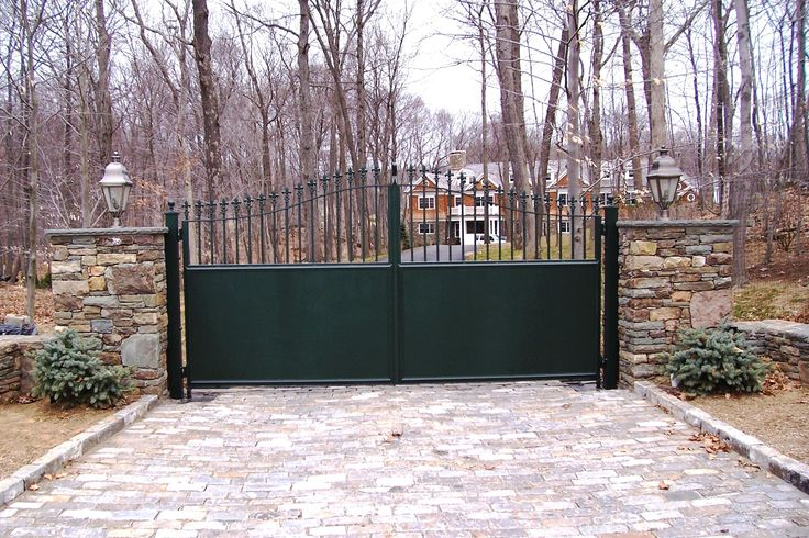 Automated wrought iron semi-privacy entrance gate