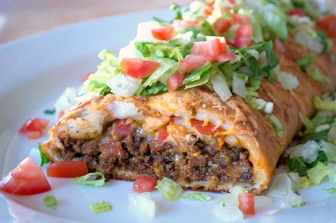 Taco Braid Recipe Main Dishes with refrigerated pizza dough, olive oil, chopped onion, lean ground beef, taco seasoning, water, shredded cheese, tomatoes, unsalted butter, romaine lettuce, sour cream, taco sauce