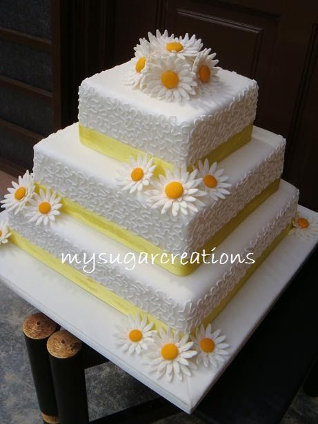 "Gerbera Daisy Wedding Cake for Yasmin. Top 2 tiers are 6"" and 9"" dummies while the bottom tier is a 12"" Lemon Butter Cake. Customer's feedba..."