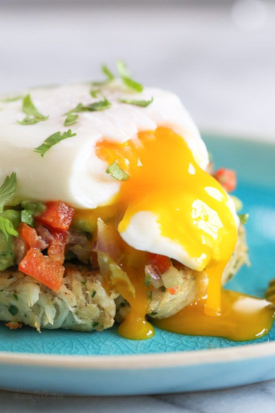 Crab cakes topped with avocado relish and a poached egg. Perfect for breakfast, lunch or brunch! Traditional Eggs Benedict are made with Hollandaise sauce, but I prefer to skip the Hollandaise which shaves off about 200 calories!