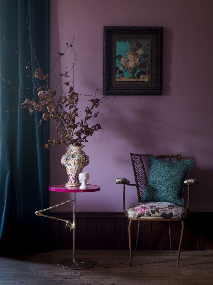 Colorful room with purple walls and blue curtains and pillows from LuxuryLondon.co.uk