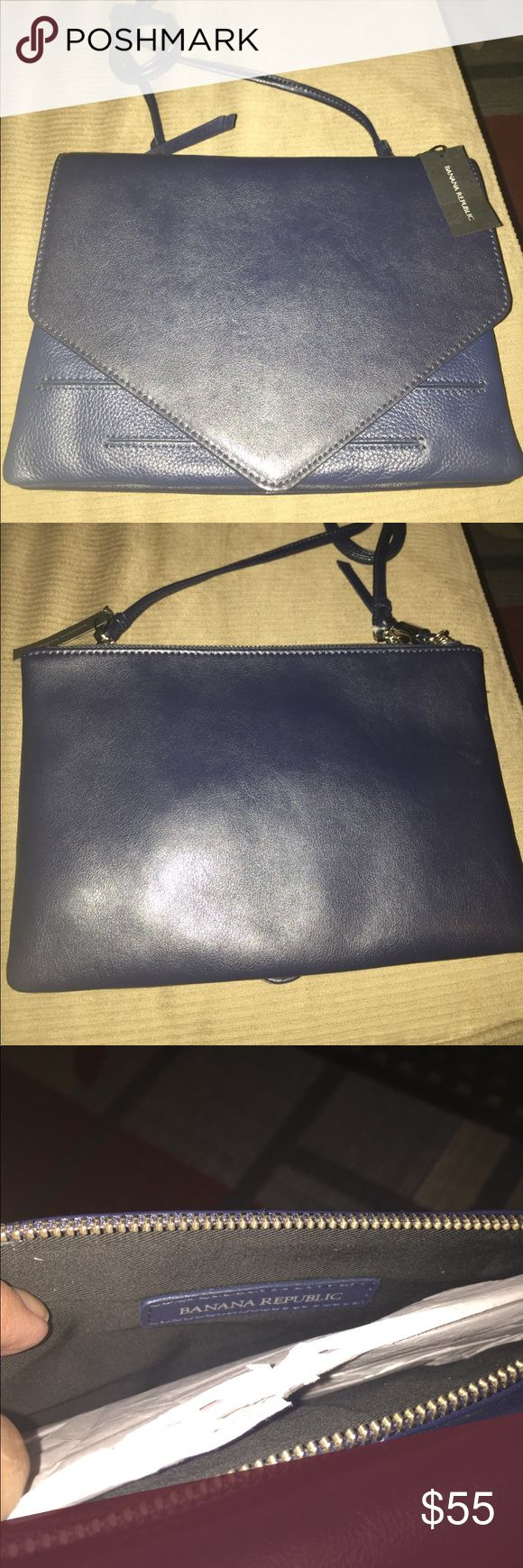 NWT BANANA REPUBLIC BLUE LEATHER SHOULDER BAG This is a brand-new blue leather banana republic handbag and has a long shoulder strap. It measures 10 inches from side to side and 7 inches from top to bottom. It has a zipper compartment on one side and a clutch compartment on the other. It really is a beautiful bag Banana Republic Bags Shoulder Bags