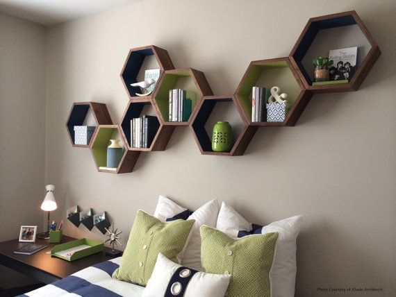 I like the idea of using geometric shelves as a sort of bed head