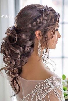 Glamorous side braided curly low updo wedding hairstyle; Featured Hairstyle: Elstile