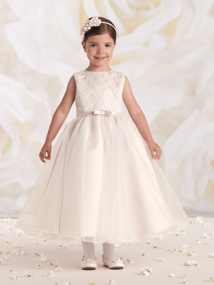 Sleeveless satin, organza and lace tea-length A-line dress, satin bodice features a cutout embroidered lace overlay, thin satin waistband with center front bow, covered buttons down back, full gathered organza overlay circle skirt, ideal as a First Communion dress. NEW for Spring 2015: Ivory/Petal. Sizes: 2 – 14