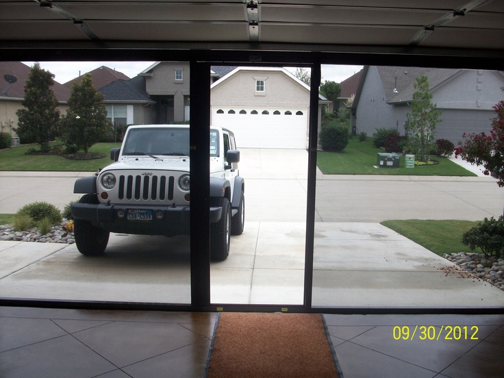 turn your garage into a mancave with a lifestyle garage door screen from cool screens texas