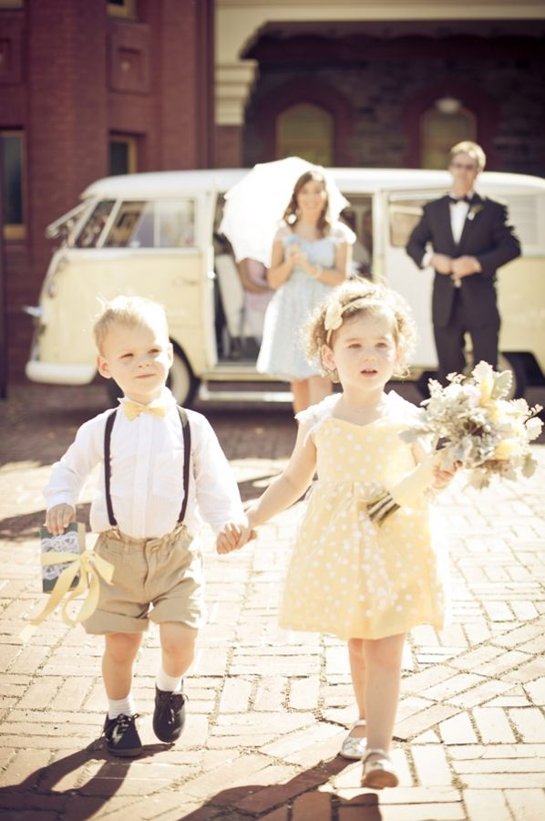 ring bearer with bow tie and flower girl in yellow dress