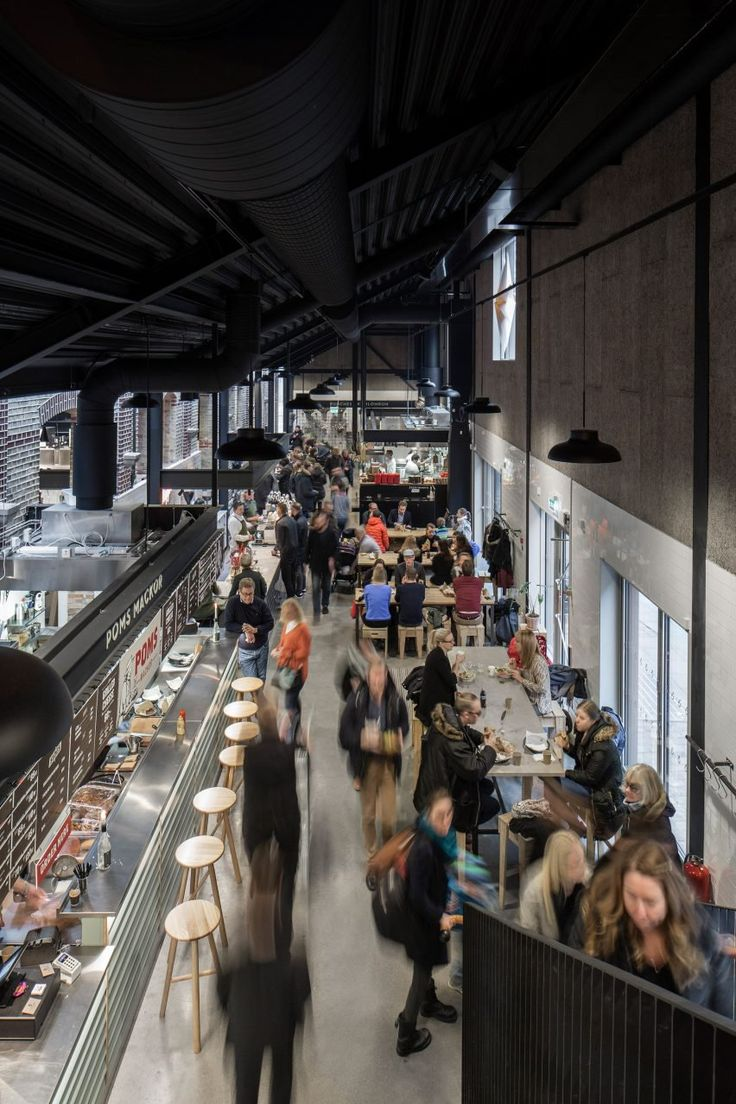The interior of Malmö Market Hall by Wingårdh Arkitektkontor was kept simple to showcase the produce being sold by traders