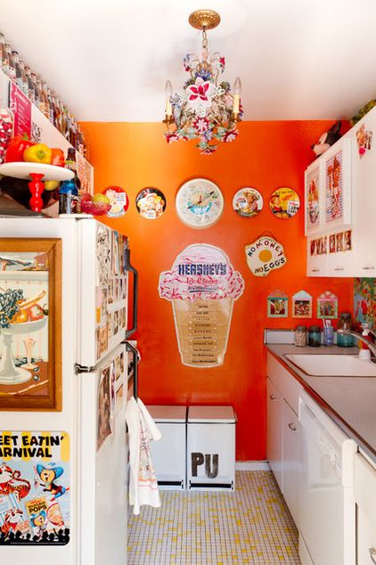 houzz.com feature photographed by @Rikki Snyder 'Engelbach painted the kitchen's back wall in a high-gloss fireball orange and added an oilcloth backsplash. With the landlord's approval, she also replaced the original linoleum floor.  A collection of filled, painted soda bottles decorates the upper cabinets. Engelbach is especially drawn to bottles from Stewart's.'