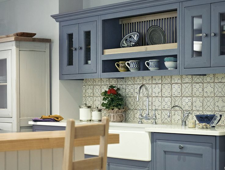 Blue grey cupboards with butler sink