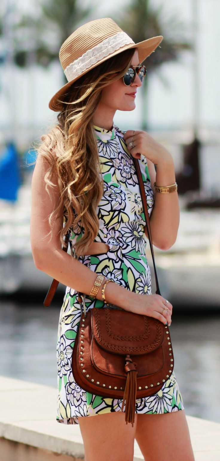 Floral cut out summer dress styled with a tassel crossbody bag and mirrored sunglasses. Perfect summer outfit!