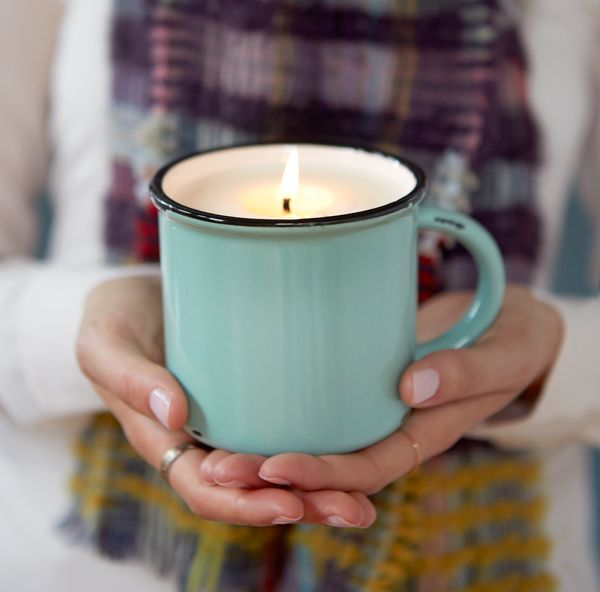 Candle in enamel mug | terrain