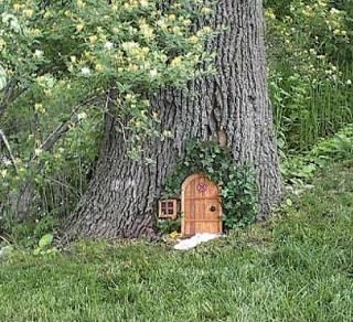 Want to put a little door on one of our trees- very cute. Maybe an extra dollhouse door?...