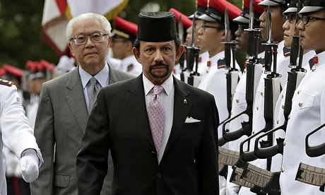 The sultan of Brunei inspects a guard of honour during a visit to Singapore last week. Photograph: Wong Maye-E/AP
