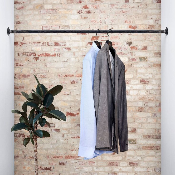 logan wall mounted clothing rail between two walls on walls coveralls id=86569