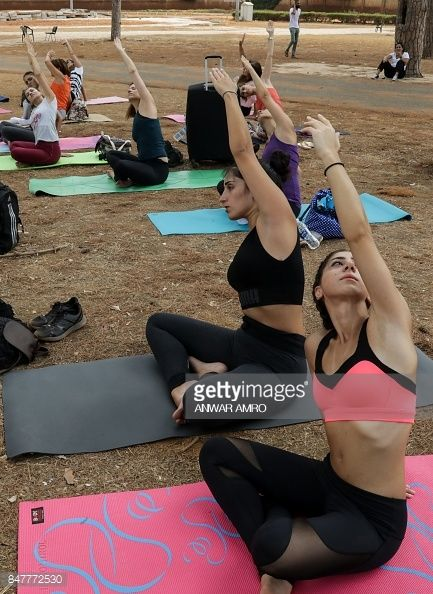 Lebanese men and women take part in the fourth edition of the 'Khod Nafas' Yoga Festival in the capital Beirut on September 16, 2017. /