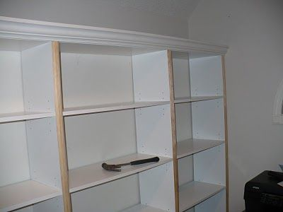prefab bookcases from walmart 25 ea with some painted crown and trim from