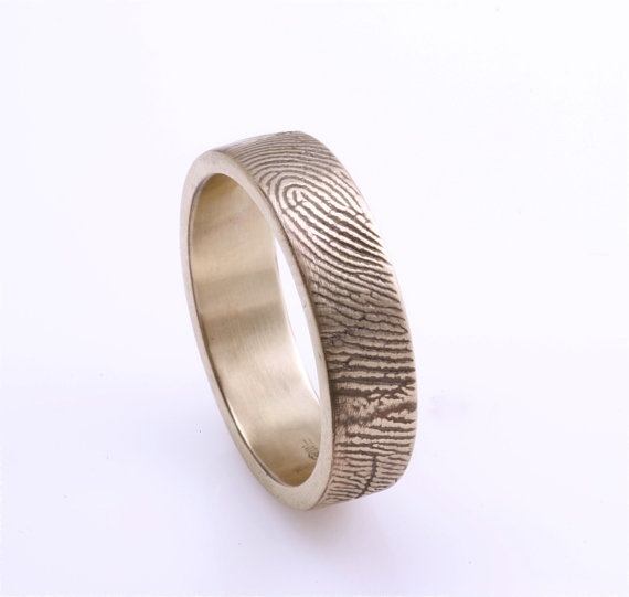 custom fingerprint ring.. this is one of the most amazing things I have ever come across. what a great idea for couples!