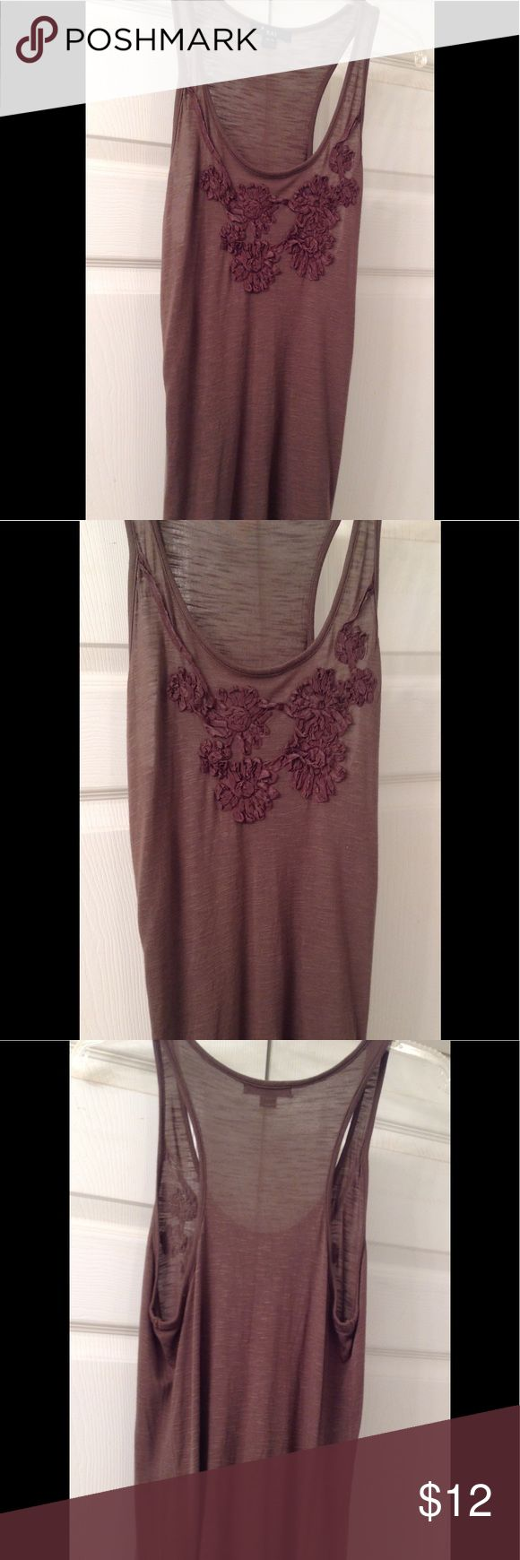 Embellished Racer Back Tank Forever XXI embellished racer back tank. Lightweight cotton tank with decorative ribbon  detail on front. Soft brown, hits at the hips. Cute with shorts, pants or skirts. Perfect for hot summer days. Looks new, excellent condition. Forever 21 Tops