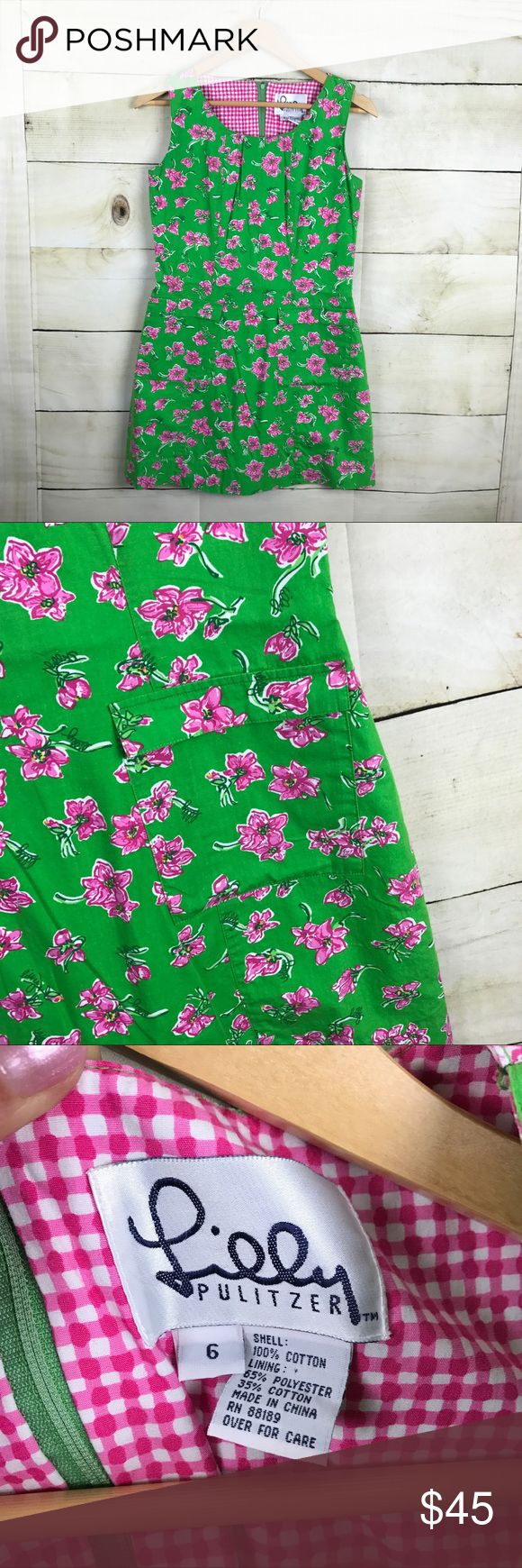 "Vintage Lilly Pulitzer Green Floral Mini Dress Adorable vintage Lilly Pulitzer mini sheath dress. Size 6. Green with pink flowers and hidden ""Lilly"" print. Two from flap pockets. Back zipper closure. Underarm-underarm 16.5"" Length 31"". 100% Cotton. Lined. Lilly Pulitzer Dresses Mini"