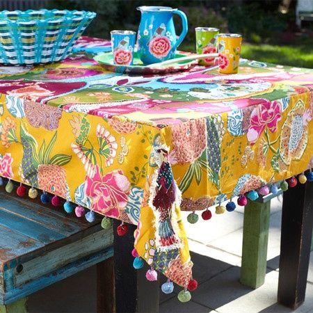 I could take a solid blue vinyl table cloth, add fringe, and put lace on top.  Would be much less likely to blow away
