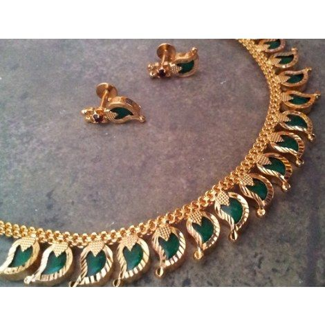 """lovely traditional Indian design from the Kerala region in India: necklace style named """"Palakka Mala""""Jewellery with mango  shaped (the origin of paisley)emeralds set nicely in quality gold -Kumkum's Jeweller"""