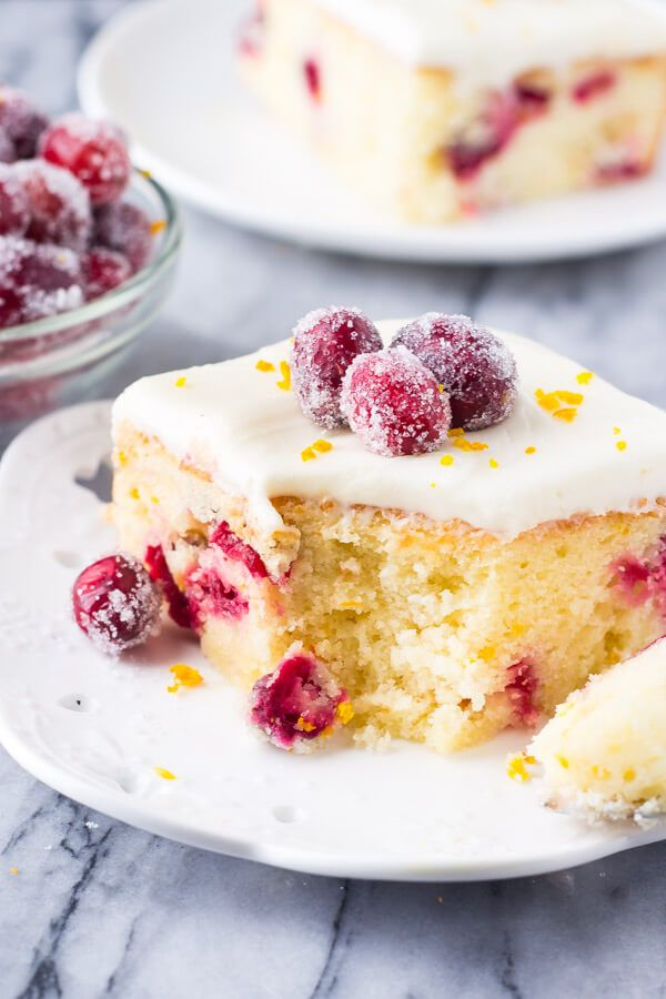 This cranberry orange cake with cream cheese frosting is bursting with holiday flavors. Perfectly moist with the softest cake crumb - the combination of sweet oranges and tart canberries makes it perfect for Christmas.