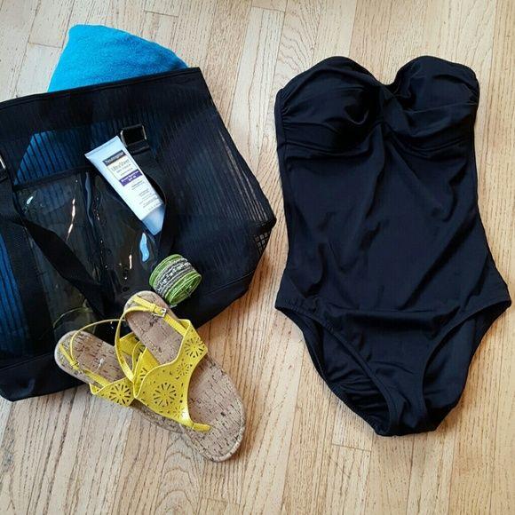 Black strapless Swimsuit J CREW black one piece strapless swimsuit.  This suit is beautiful on, very flattering. Never worn. Excellent condition. J. Crew Swim One Pieces