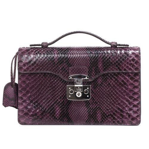 """Authentic Gucci Python Lady Lock Briefcase Clutch.  CONDITION: Very good.  Faint mark on interior leather.  Material: Python Color: Dark purple Exterior Features: Top handle, flap opening with push lock closure, silver tone hardware Interior Features: Purple suede lining, open pocket, zipped pocket Measurements: 11"""" x 7"""" x 2.5"""" Included: Gucci dust pouch SKU: HA02085"""