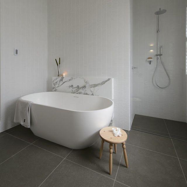 The Block All Stars winning bathroom. Grey floor tiles, white wall tiles, free standing bath and marble splashback.