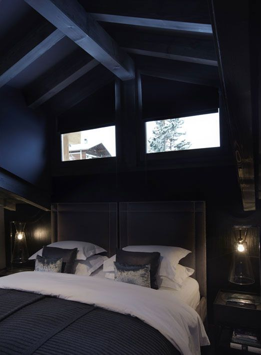 Charcoal/Navy Paint envelopes this room in the color of the Midnight. The dark Linens, and Oil Style outdoor Lamps create a Cabin Feeling. Fiona Barratt Interiors