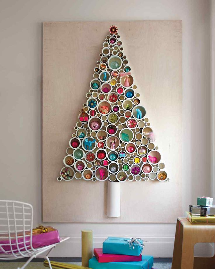 Christmas Decor Ideas - 14 DIY Alternative Modern Christmas Trees | Thin slices of PVC pipe have been attached to a sheet of plywood and filled with fun ornaments to create a festive Christmas tree alternative that can be used year after year.
