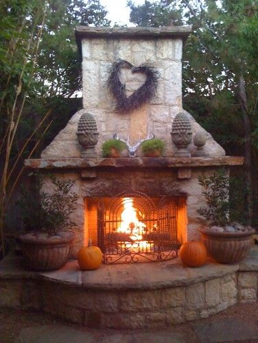 Love outdoor fireplace hearth