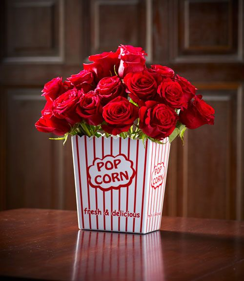 "For a centerpiece with vintage movie-theater charm, pile red roses into a ""popcorn-bowl vase"" ($15, surlatable.com).  - GoodHousekeeping.com"