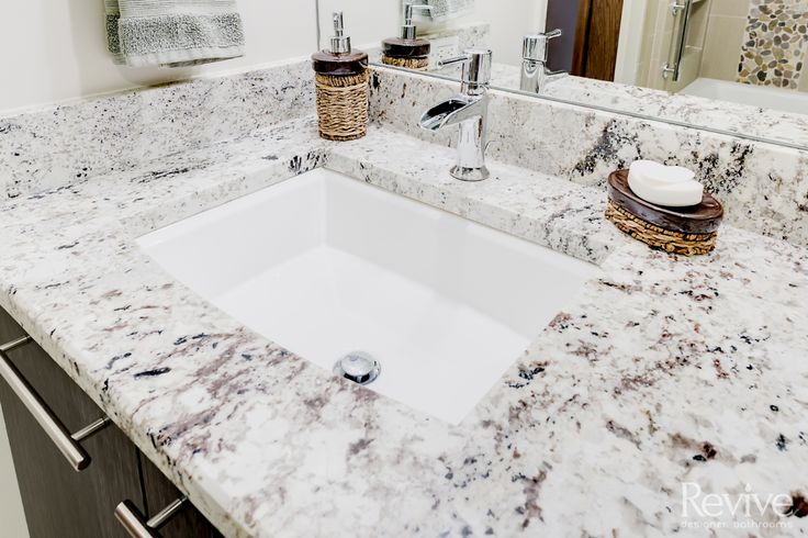 The granite vanity makes the space feel both natural and contemporary. Accentuating the calming colors of the room, it's a great place to get ready in the morning.