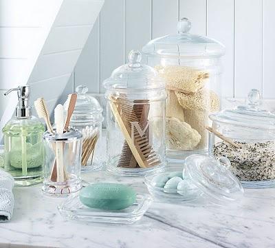 Pretty display of useful bathroom items-glass, silver ...