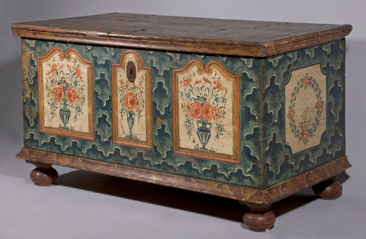 An Austrian Empire painted chest with the original blue marbling or jigsaw decoration favoured in the Giant Mountains. It has carved and floral decorated arched fielded panels. These boxes were often made to commemorate a marriage. Austrian Empire, circa 1820.  Width: 122cms (48 inches)  Depth: 63cms (25 inches)  Height: 67cms (26.5 inches)