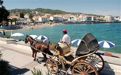 Spetses, Greece - cars are banned so they ride in carriages
