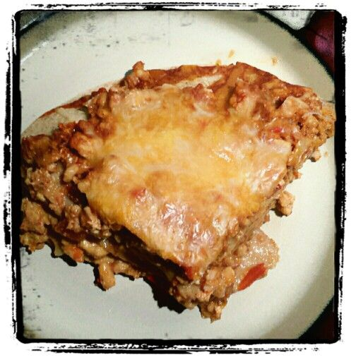 Turkey Enchilada bake: place 1 lb of extra lean ground turkey in the slow cooker…