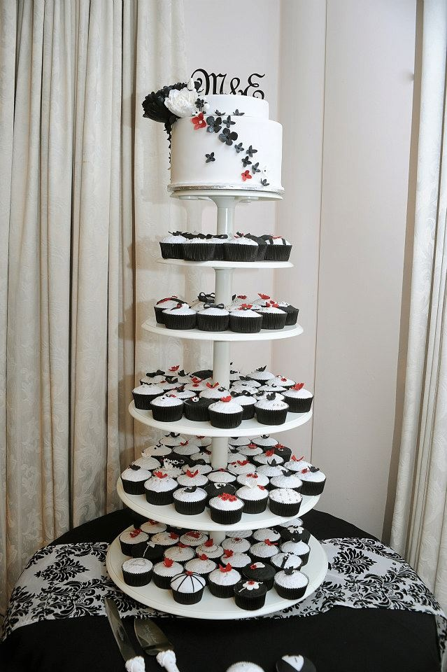 Wedding cake cup cake tower - black & white with a touch of red.