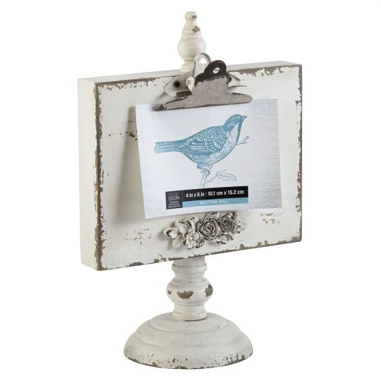 <div>Display a cherished photograph or picture on this pretty pedestal frame with its raised ros...