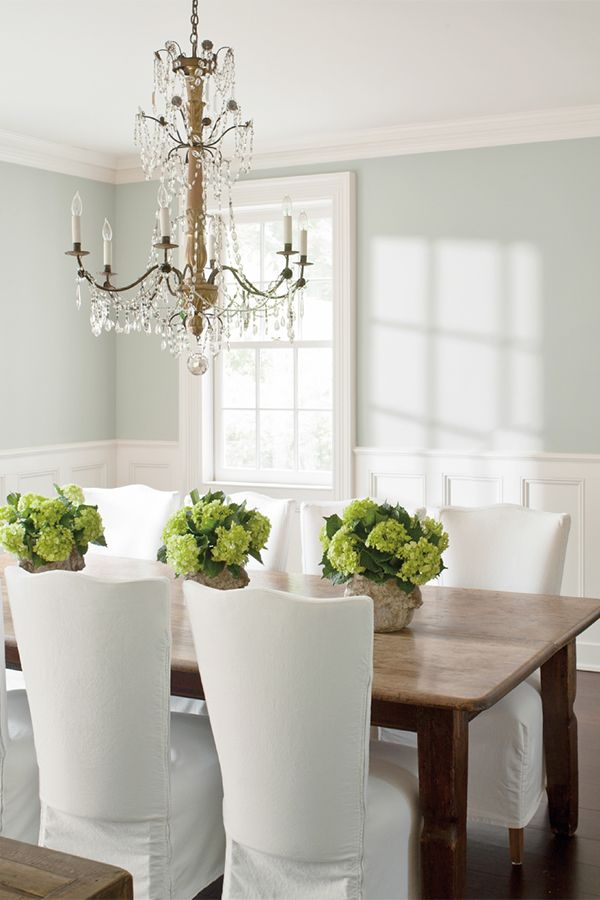 Wood table in dining room with formal white chairs