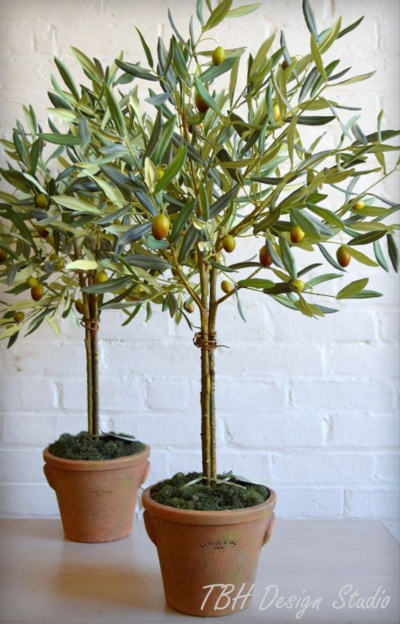 """So perfectly realistic, you'll be reaching for the olives! Set in GWolf&Co terracotta pots, your home will take on the air of Tuscany all summer long. Approximately 32"""" tall and 24"""" wide, this piece i"""