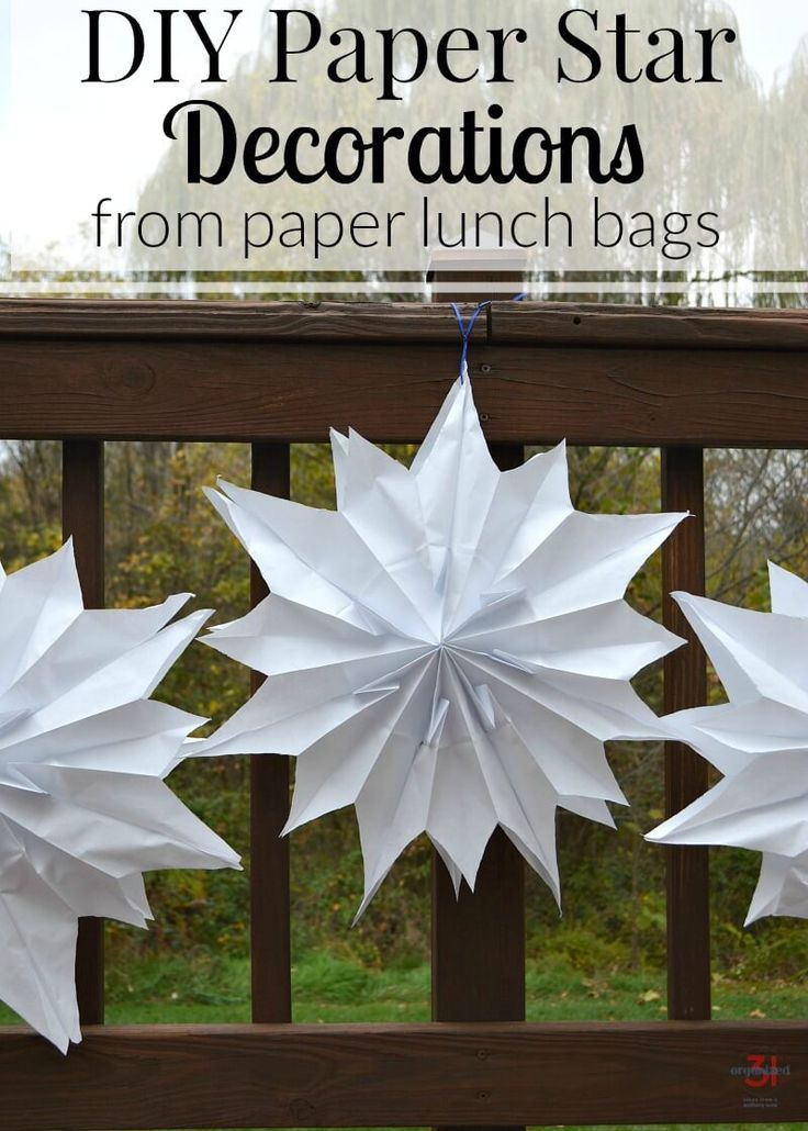 Make your own DIY Paper Star Decorations using inexpensive paper lunch bags. Paper stars are perfect for weddings, graduation, birthday parties and more. #graduation #weddings #partydecor